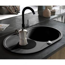 Fregadero de cocina de granito con un seno ovalado negro